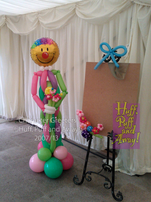 Wroxall Abbey: Clown figure with decorated table plan easel. Decor and Sculpture by Huff, Puff and Away!
