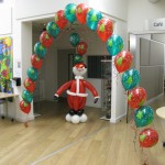 Christmas decor: A jolly Santa and balloon arch by Huff, Puff and Away!