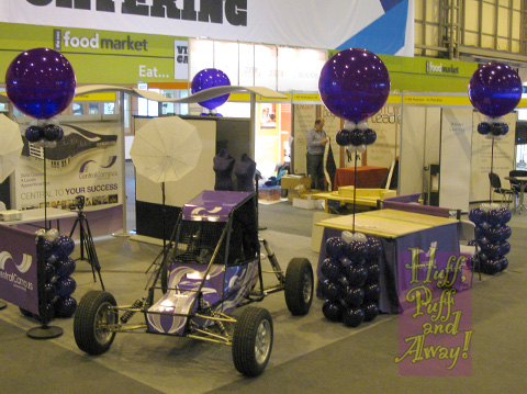 Giant balloons on dressed armatures, on the Sandwell College stand at the NEC Skills Show