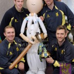 Warwickshire players pose with Huff, Puff and Away Cricketer Greeter at the Ronald McDonald House Birmingham 3rd Birthday celebrations